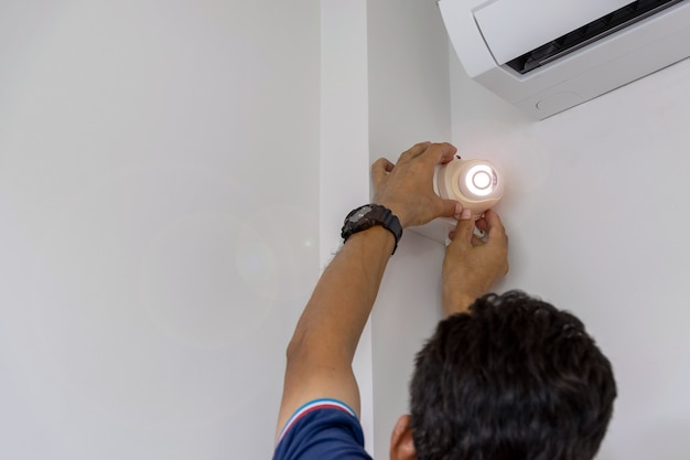 Technicians are installing a cctv camera on the wall Premium Photo