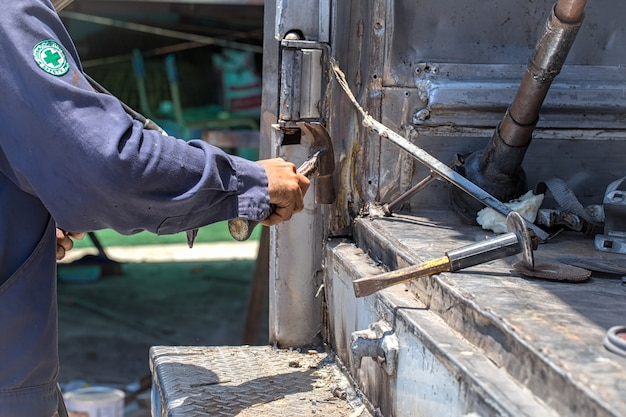 Technicians are using a hammer for work  Photo | Premium Download