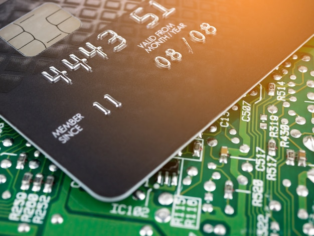 Technology credit card on printed board circuit Premium Photo