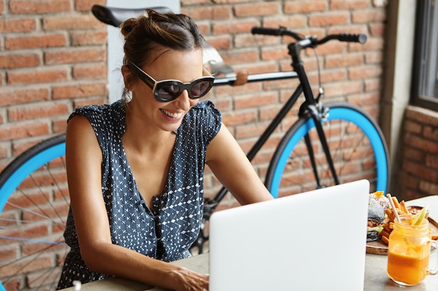 Technology and leisure concept. attractive woman wearing