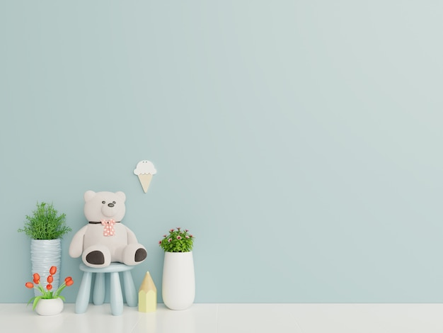 Teddy bear in the children's room on blue wall background. Premium Photo