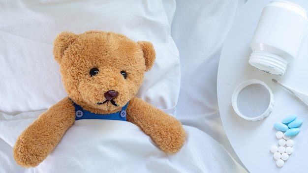 Teddy bear is ill from the flu and virus infection Premium Photo