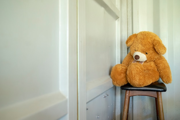 Teddy bear sitting lonely waiting for something back. Premium Photo