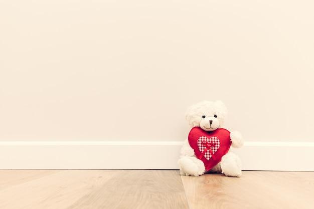 Teddy bear with heart Free Photo