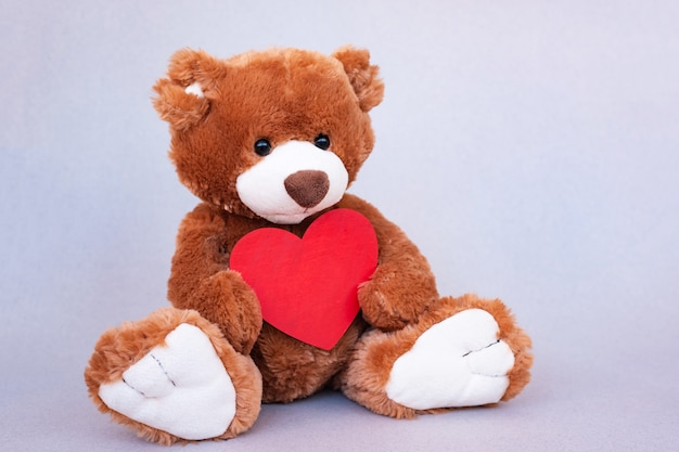 Teddy bear with red heart. valentines day gift. Premium Photo