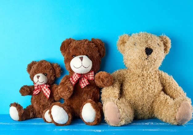 Teddy bears on a blue background, friendship concept Premium Photo