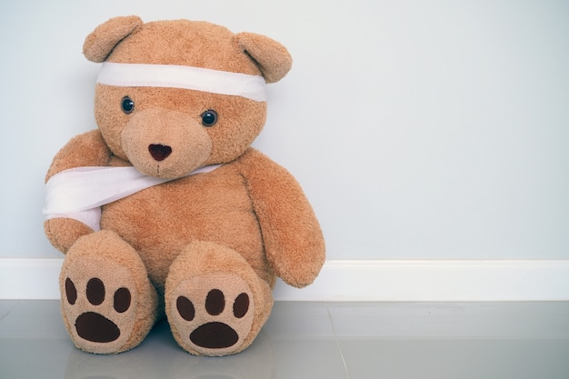 Teddy bears have gauze, wound on the arms and head. child injury concept Premium Photo