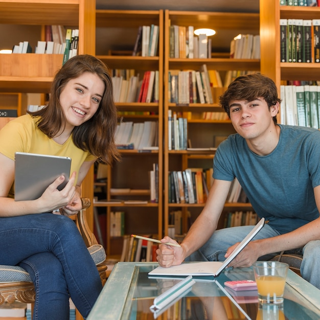 Teen couple with tablet doing homework 23 2147860630