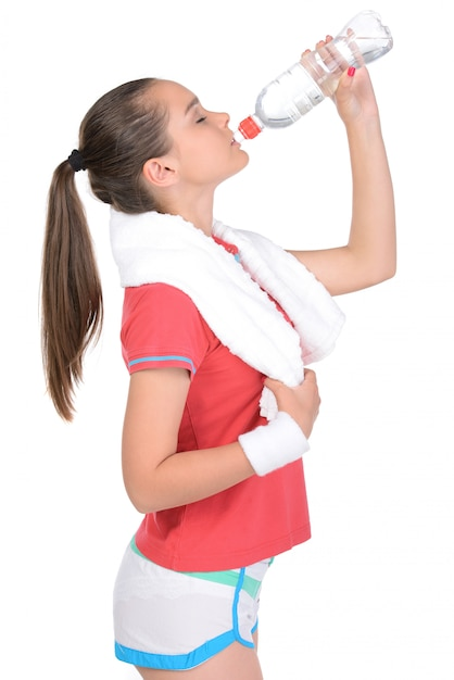 Teen girl fitness workout, holding towel and water  Photo | Premium