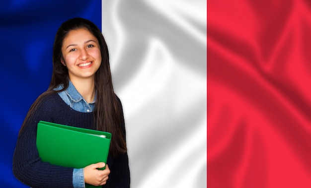 Teen student smiling over french flag Premium Photo