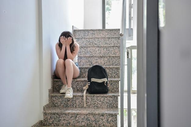 Teenage girl has no friends at school. Premium Photo