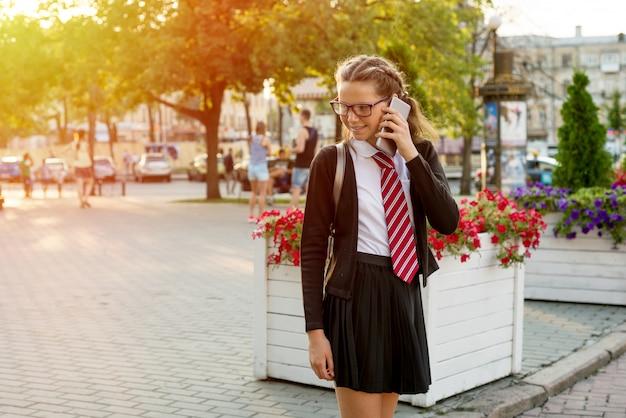 Teenage girl high school student on city street Premium Photo