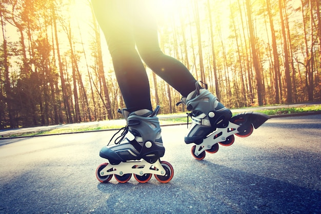Teenage girl on roller skates at summer. Free Photo