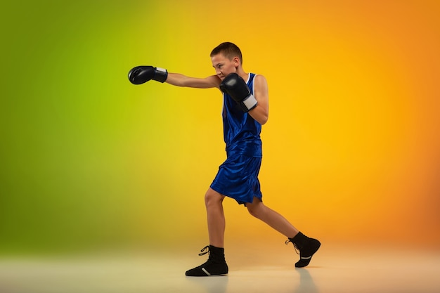 Teenage professional boxer training Free Photo