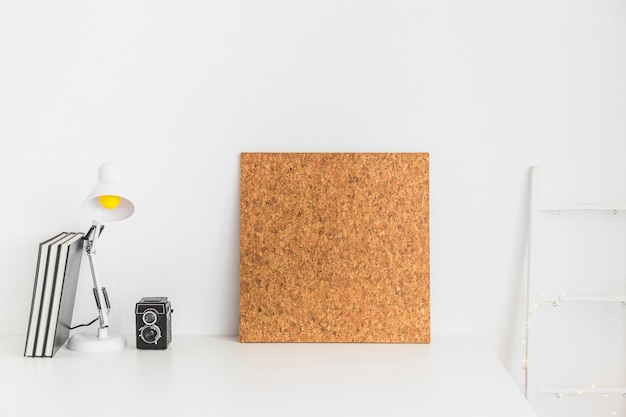 Teenage workspace in white color with cork board Free Photo