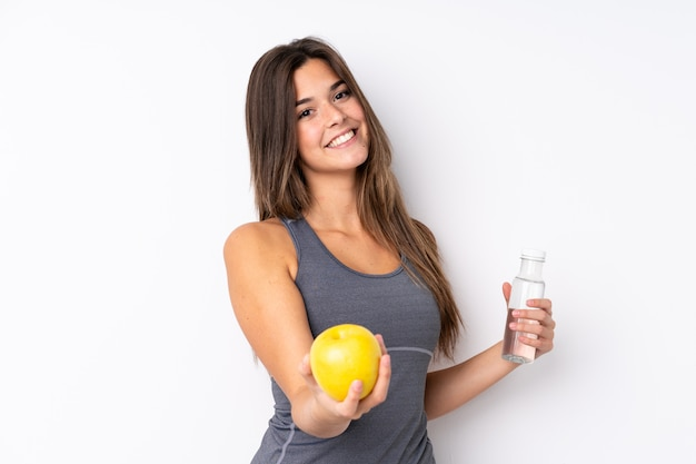 Teenager brazilian girl with an apple and a with a bottle of water Premium Photo