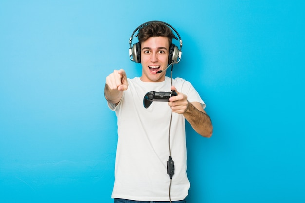 Teenager caucasian man using headphones and game controller Premium Photo