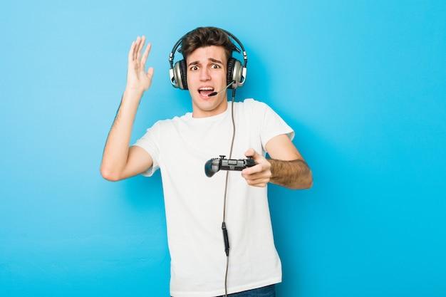 Teenager caucasian man using headphones and game controller Premium Photo