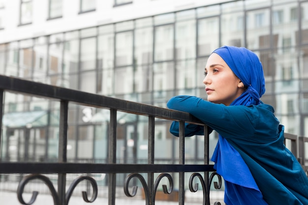 Teenager girl with hijab posing with copy space Free Photo