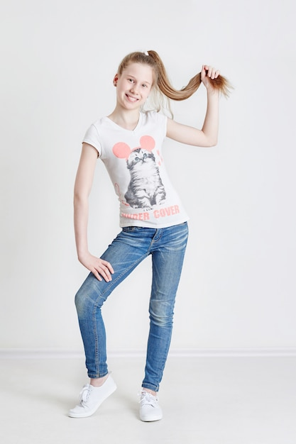 Teenager girl with a long braid posing Premium Photo