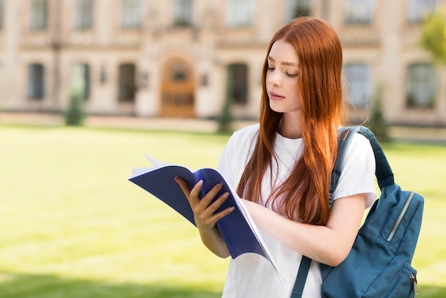 Teenager looking through project notes Premium Photo