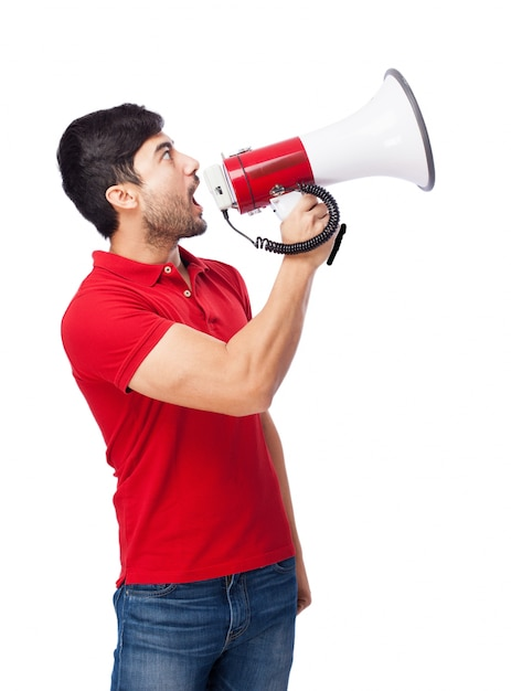 Teenager looking up with the megaphone Free Photo
