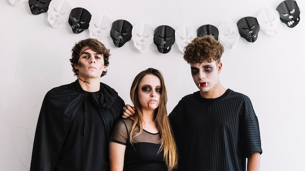 Teenagers in halloween costumes of zombie and vampires Free Photo