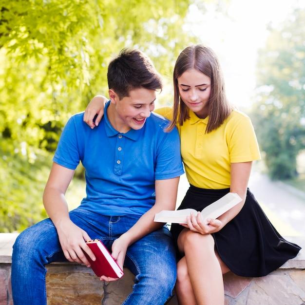 Teens reading books outside 23 2147668948