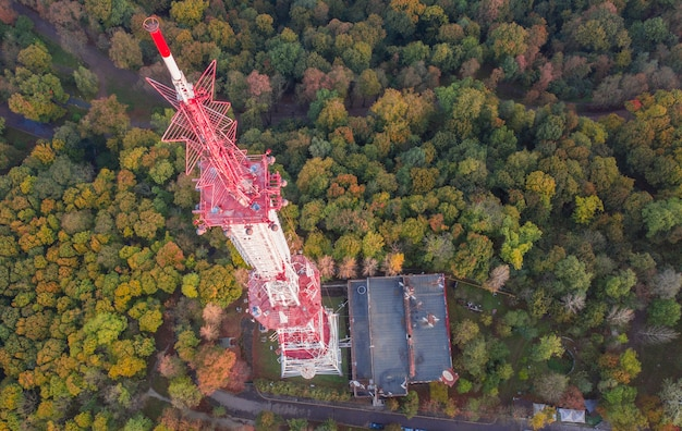 Telecommunication tower for mobile phone service and wireless 5g communication. against the background of the forest Premium Photo