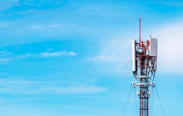 Telecommunication tower with blue sky and white clouds background. antenna on blue sky. radio and satellite pole. communication technology. telecommunication industry. mobile or telecom 4g network. Premium Photo