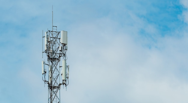 Telecommunication tower with blue sky and white clouds background antenna on blue sky radio and satellite pole communication Premium Photo