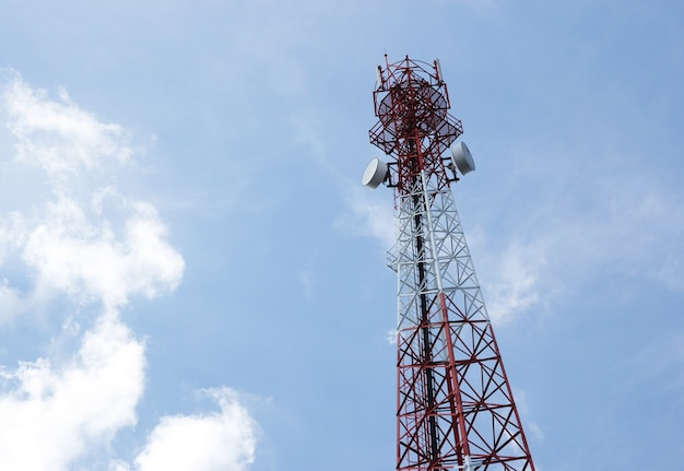Telecommunications antenna for radio, television and telephone with cloud and blue sky Free Photo