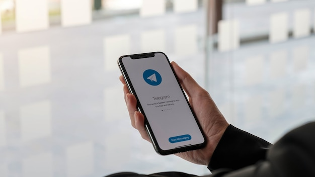 Telegram application icon on screen close-up. telegram app icon. telegram is an online social media network. social media app Premium Photo