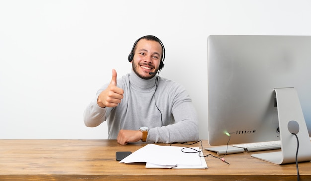 Telemarketer colombian man with thumbs up because something good has happened Premium Photo