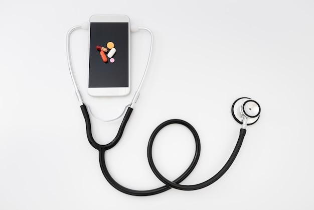 Telemedicine. smartphone and stethoscope, health care, medicine, hospital Premium Photo