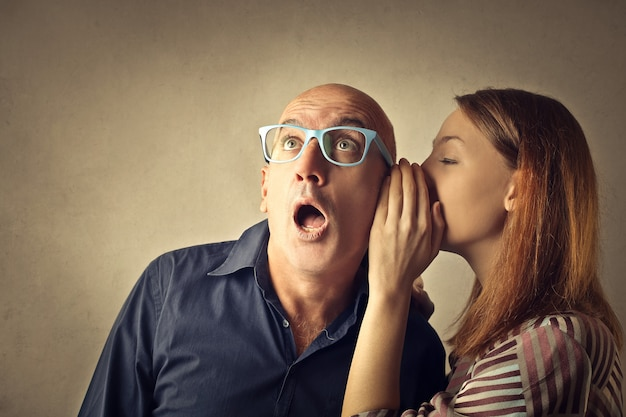 Telling and sharing a secret Premium Photo