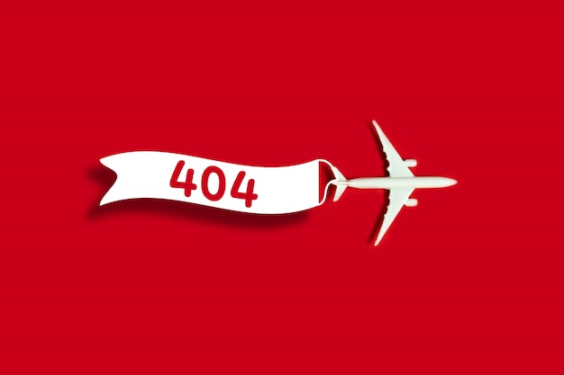 Template reports that the page is not found with a toy airplane model and a ribbon Premium Photo