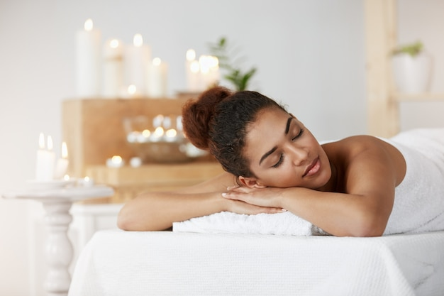 Tender african woman resting relaxing with closed eyes in spa salon. Free Photo