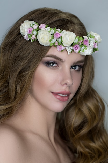 Tender beauty portrait of bride with flowers wreath in hair Premium Photo