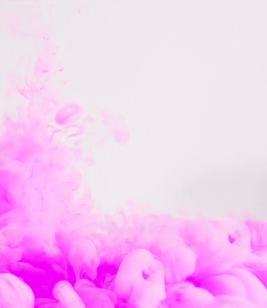 Tender flowing pink ink cloud Free Photo
