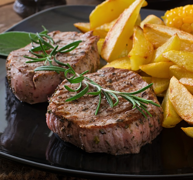 Tender and juicy veal steak medium rare with french fries Premium Photo
