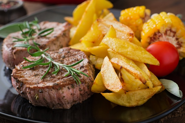 Tender and juicy veal steak medium rare with french fries Free Photo