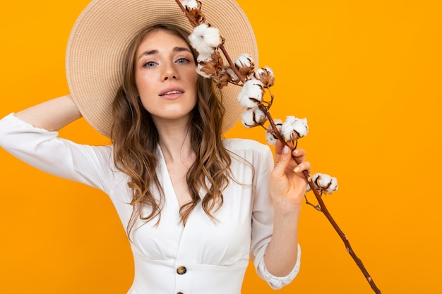 Tender portrait of a girl with a sprig of cotton in her hands Premium Photo
