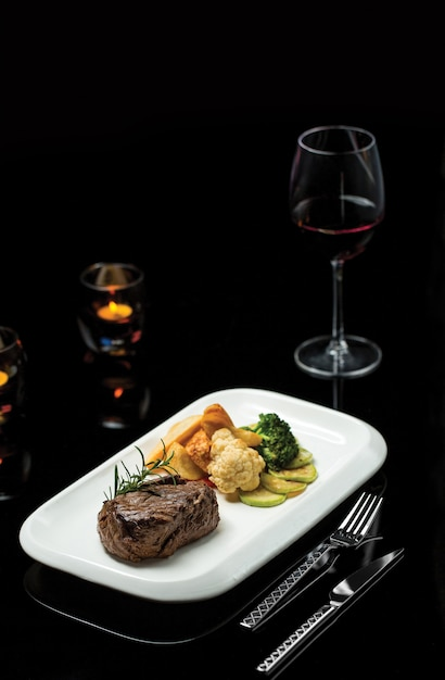 Tenderloin steak with snacks and sauces Free Photo