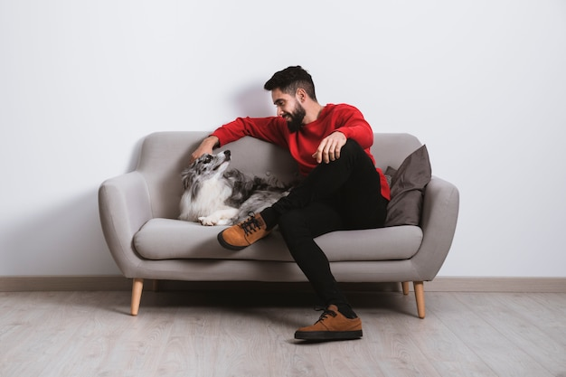 Tenderness scene with his nice pet Free Photo