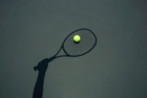 Tennis ball with racket on the tennis court. Premium Photo
