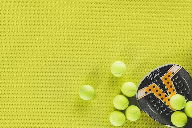 Tennis balls and racket Free Photo