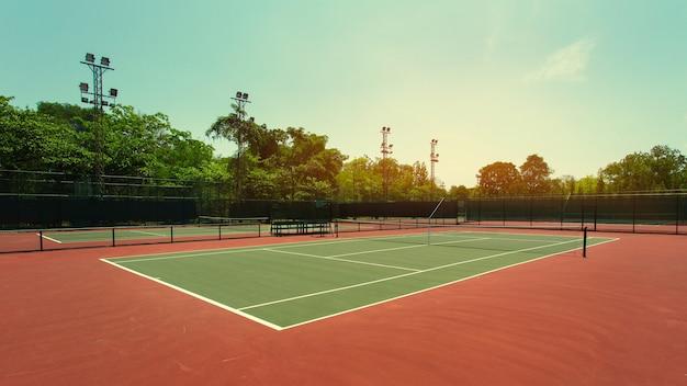 Tennis court on sunset Premium Photo