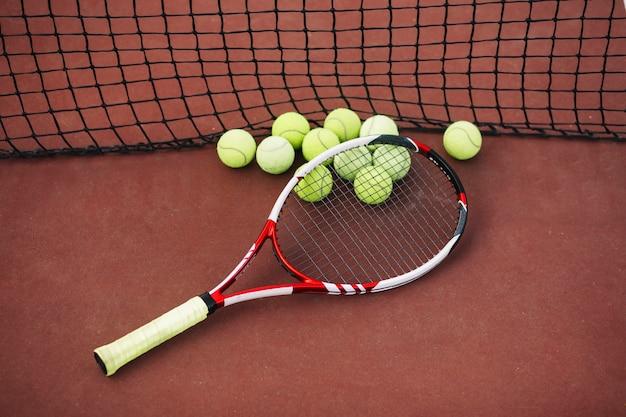 Tennis equipment on the field Free Photo