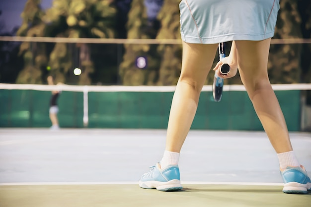 Tennis match which the opponent serving lady player Free Photo